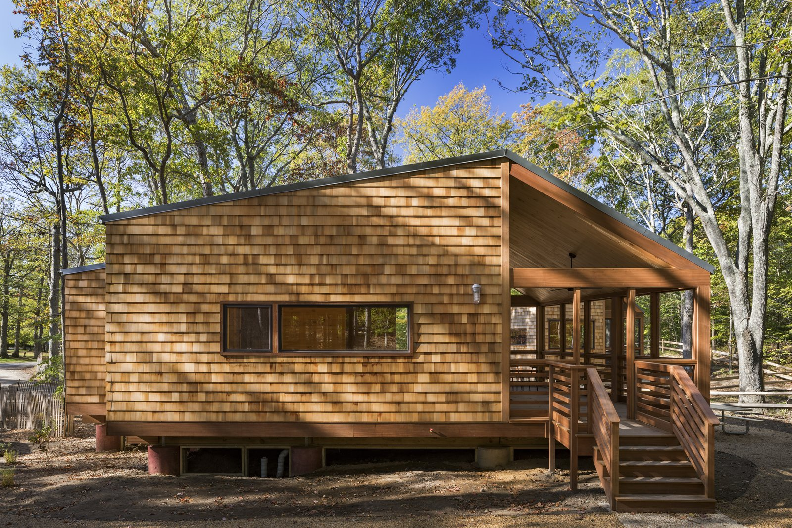 Exterior, Metal Roof Material, Wood Siding Material, Gable RoofLine, and Cabin Building Type  Photo 4 of 7 in A Long Island Campground Gets a Bunch of New Modern Cabins