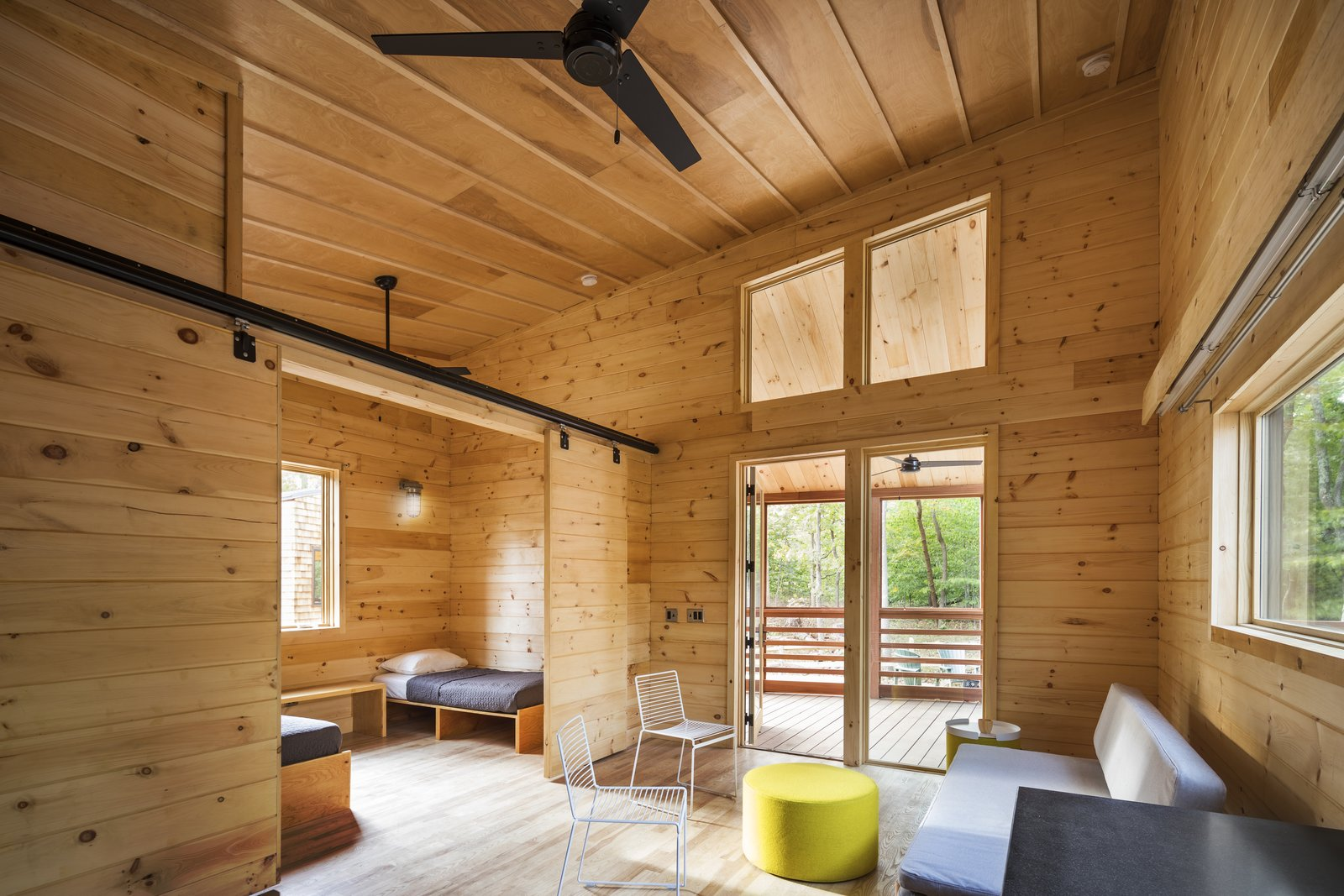 Living Room, Sofa, Ottomans, Light Hardwood Floor, and Chair  Photo 5 of 7 in A Long Island Campground Gets a Bunch of New Modern Cabins