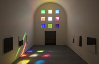 Inside, the sun shines through the colorful stained glass windows.
