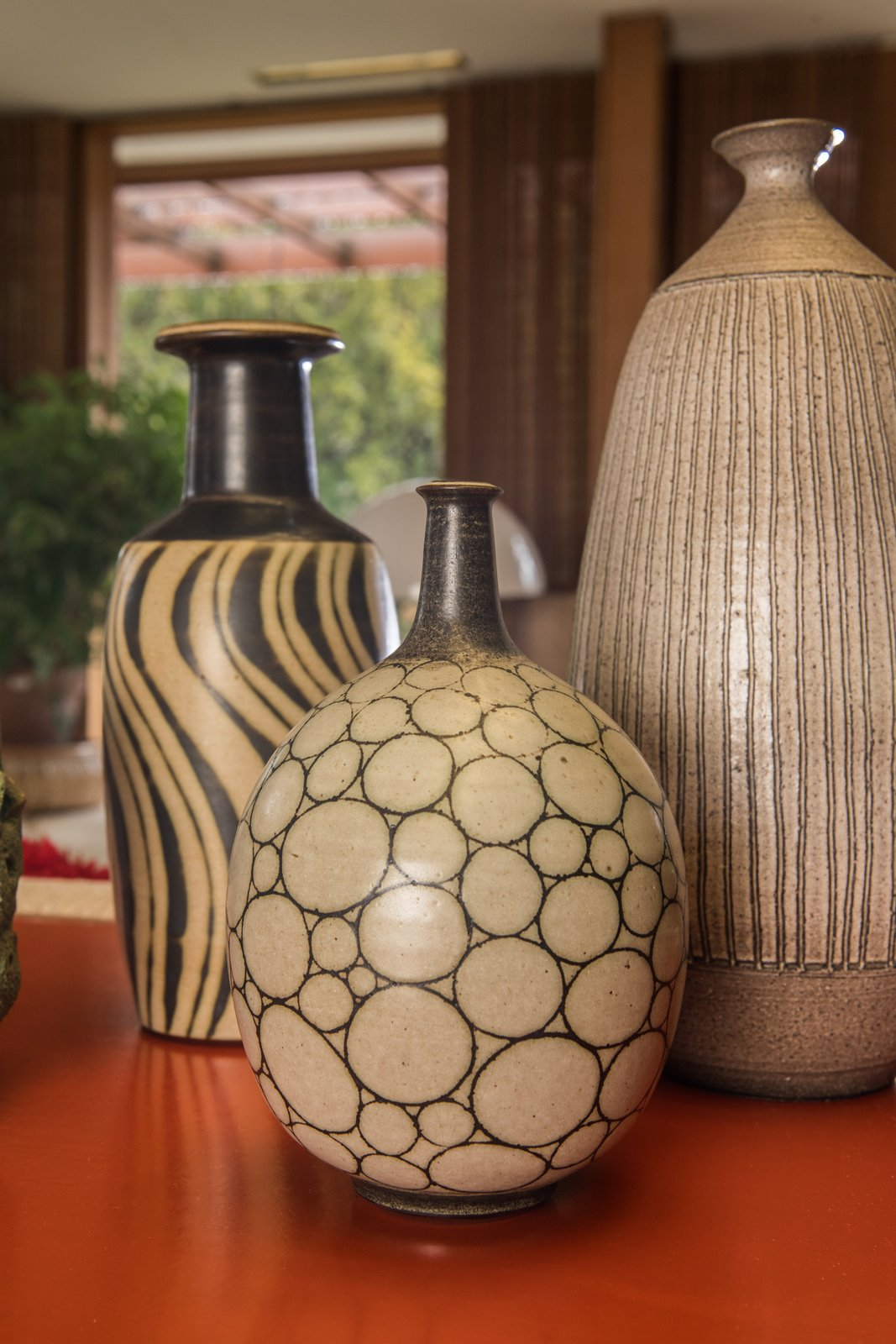 Three vases by Harrison McIntosh are displayed in the living room.