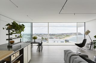 A transparent balcony allows unobstructed views of the sea and Newcastle's city skyline.