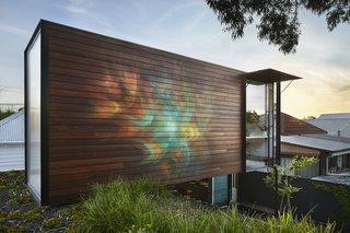 "On the exterior of the office, a mural dubbed ""Awakened Flow"" by Seb Humphreys echoes the tranquil energy of the home."