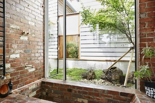 The shower area and sunken brick tub were constructed using red clay bricks salvaged from demolition sites around Victoria.