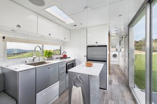 Taking design cues from boats, the Hofmanns used maintenance-free, weather-resistant aluminum for the interior walls and midcentury-style cabinetry. High-end appliances like a dishwasher and washer-drier combo are small and tucked away.