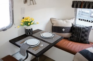 Cole outfitted the interior with a chic yet casual black, white, and brown color scheme.