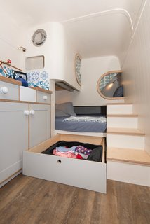 Storage for bulky ski equipment and clothing was built under the main bed.