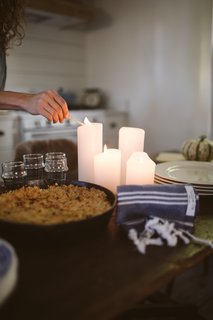 Create soft lighting with candles or a crackling fire.