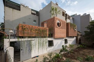 Indoor Gardens Bring Light and Air Into This Brick Home in Vietnam