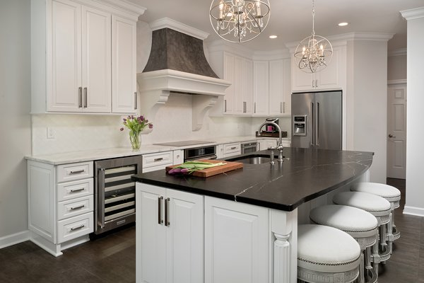 Contrasting countertops and cabinetry bring a modern touch to an otherwise traditional kitchen in North Carolina.