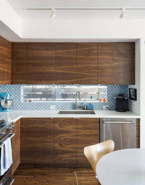 Santa Monica Connect 4L Kitchen Detail with book matched walnut cabinet fronts by Semihandmade.