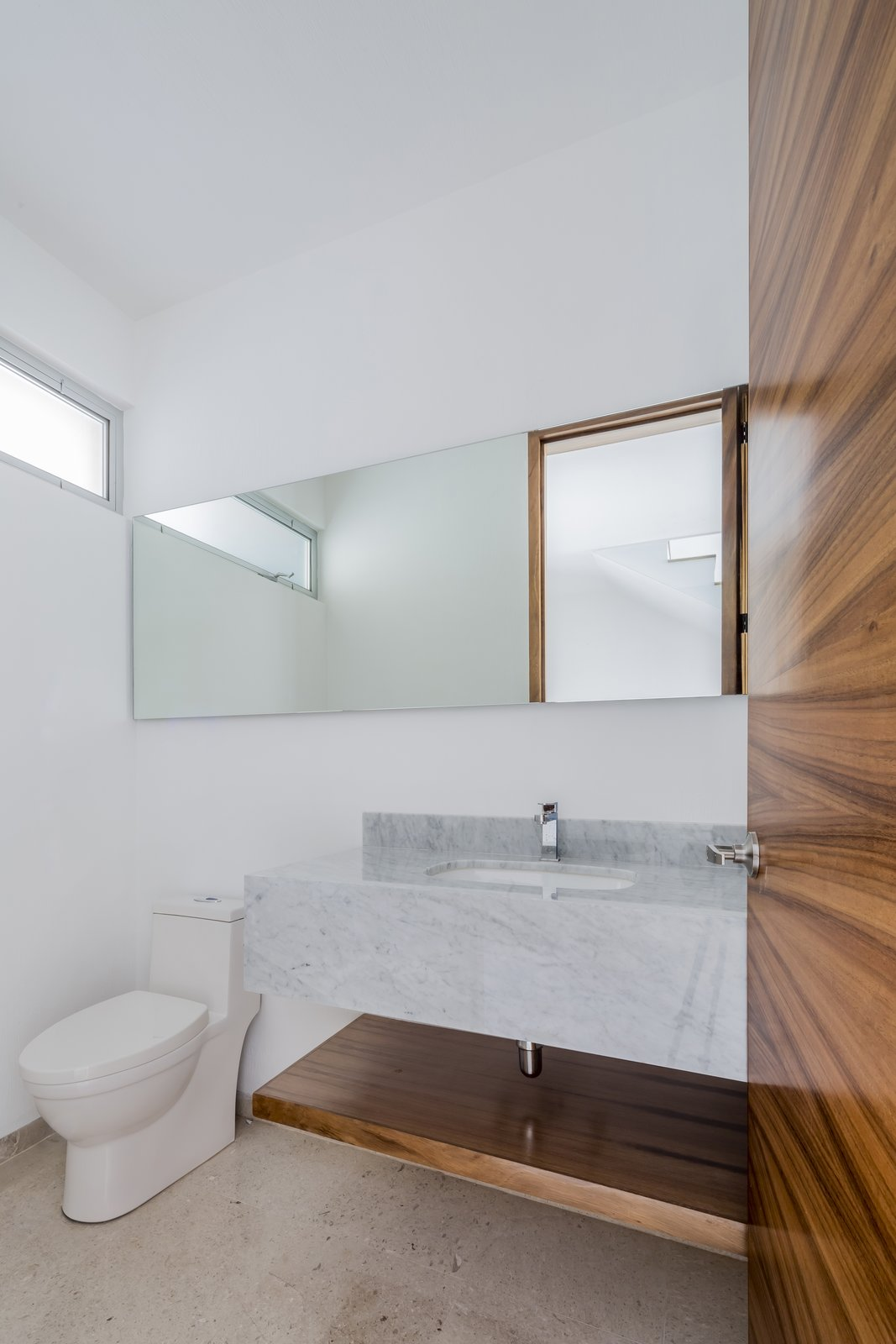 Bath Room, Marble Counter, Marble Floor, Ceiling Lighting, and One Piece Toilet  CASA VALLE by Sergio Villalobos