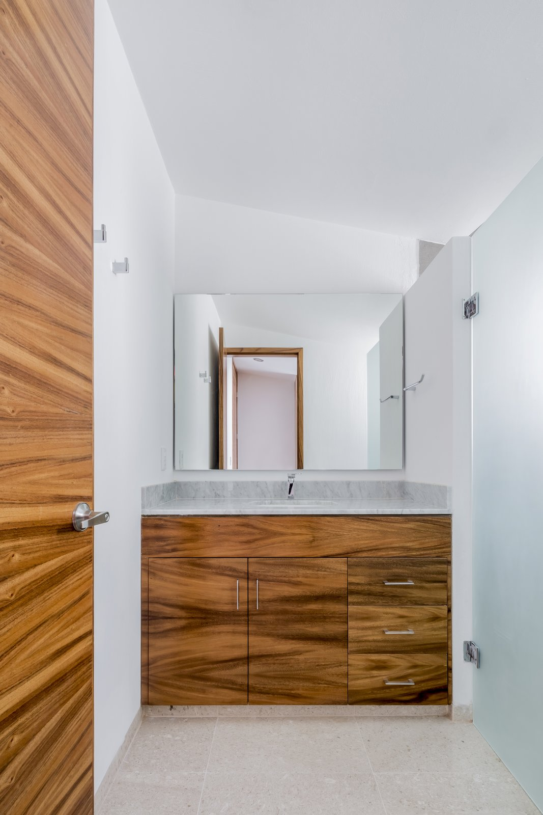 Bath Room, Marble Floor, Marble Counter, and Ceiling Lighting  CASA VALLE by Sergio Villalobos