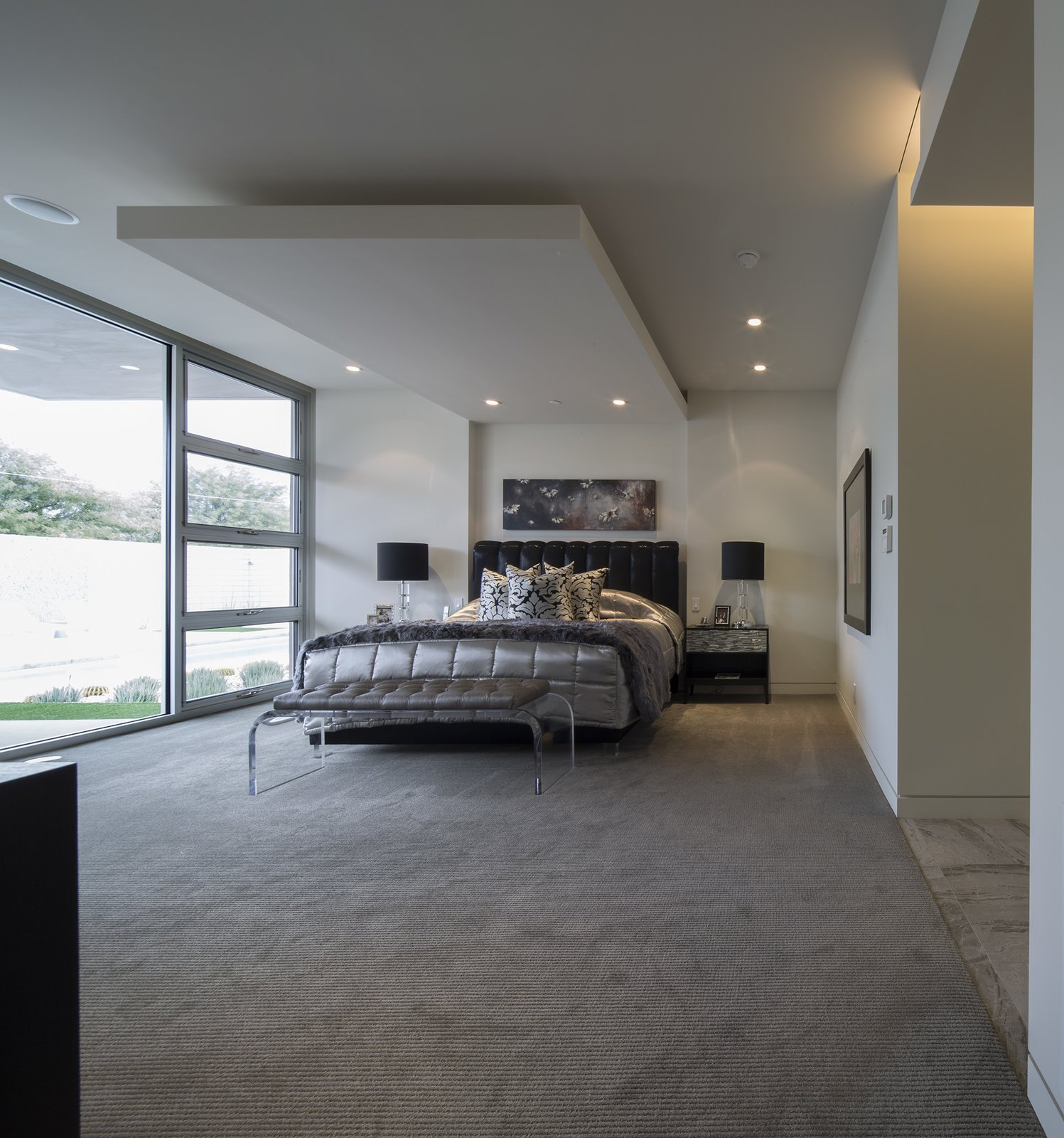 Bedroom, Night Stands, Bed, Dresser, Bench, Table Lighting, Recessed Lighting, Porcelain Tile Floor, and Carpet Floor  Birds Nest