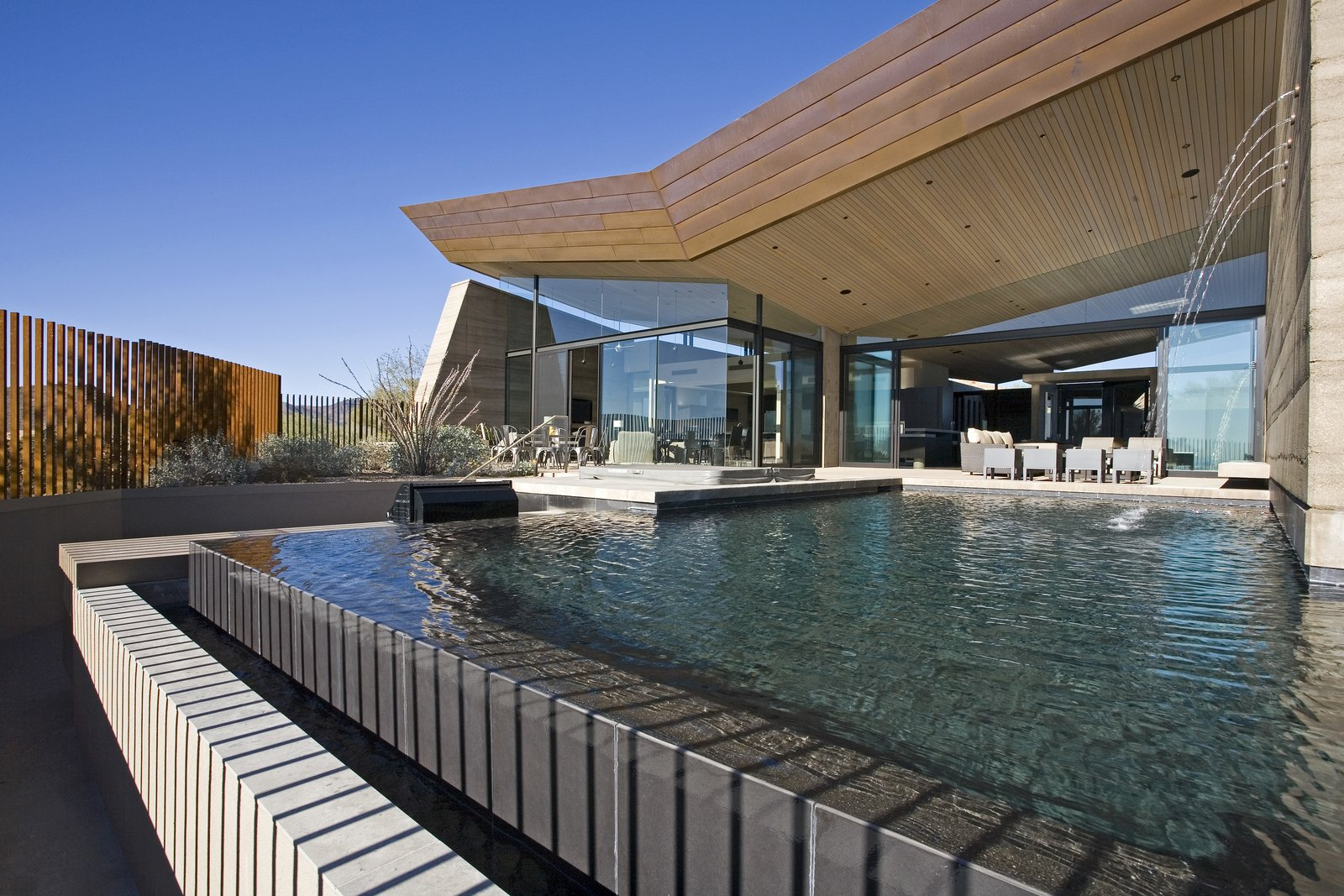 Outdoor, Trees, Hardscapes, Back Yard, Shrubs, Large Pools, Tubs, Shower, Infinity Pools, Tubs, Shower, Swimming Pools, Tubs, Shower, Large Patio, Porch, Deck, Gardens, Concrete Pools, Tubs, Shower, Concrete Patio, Porch, Deck, and Vertical Fences, Wall  Desert Wing