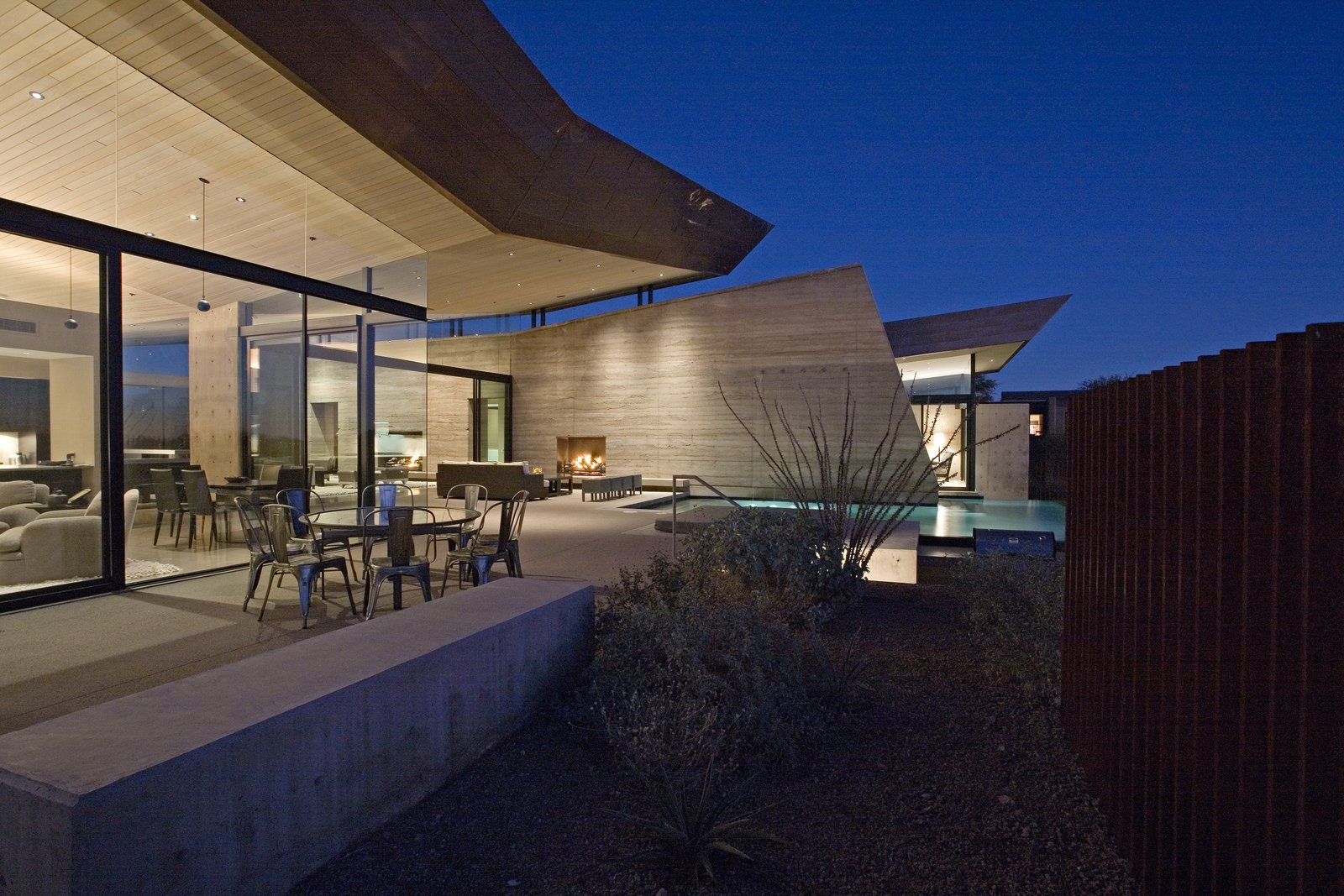 Outdoor, Trees, Hardscapes, Shrubs, Desert, Back Yard, Large Pools, Tubs, Shower, Infinity Pools, Tubs, Shower, Swimming Pools, Tubs, Shower, Concrete Pools, Tubs, Shower, Concrete Patio, Porch, Deck, Large Patio, Porch, Deck, Vertical Fences, Wall, and Metal Fences, Wall  Desert Wing
