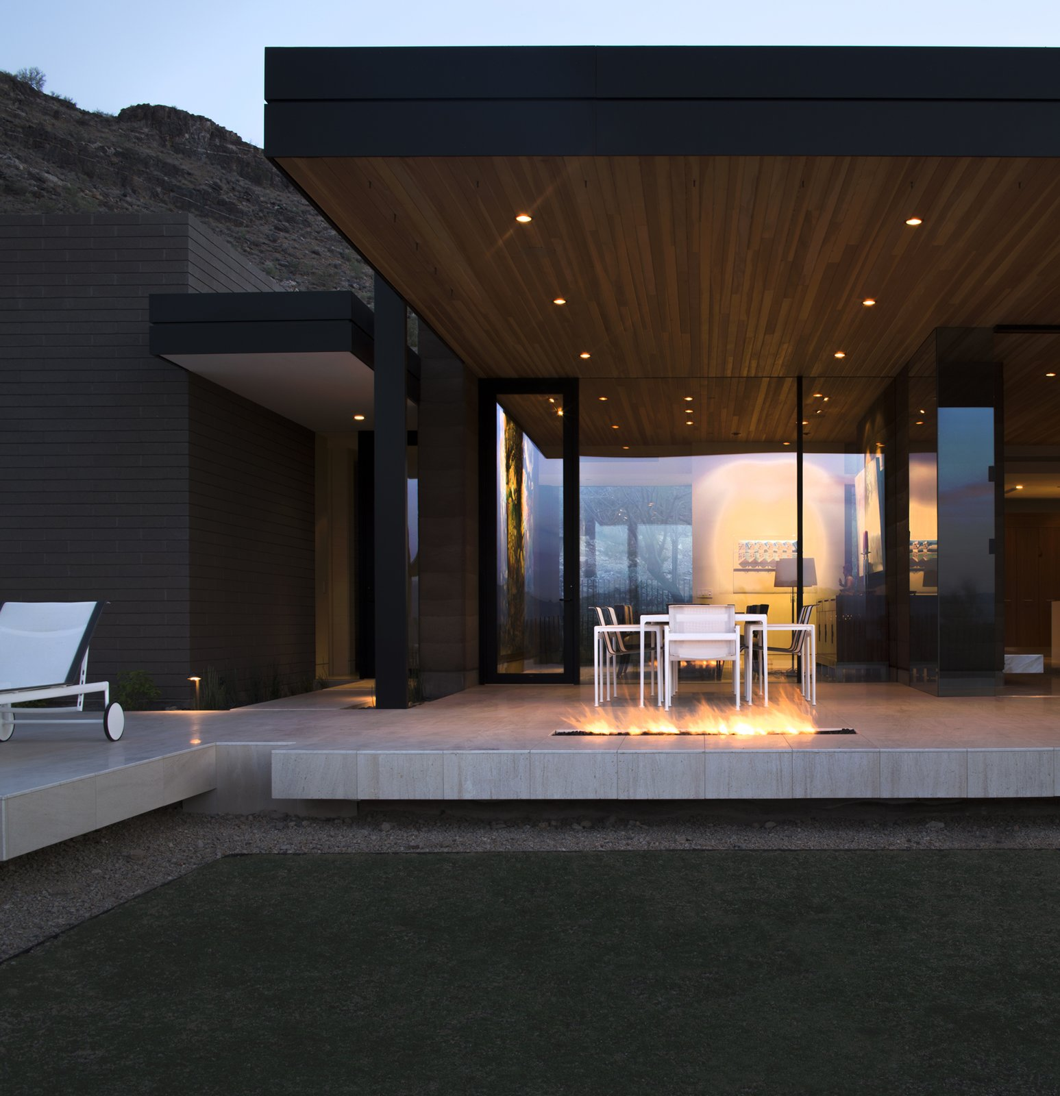Outdoor, Hardscapes, Grass, Large Patio, Porch, Deck, Back Yard, and Stone Patio, Porch, Deck  Rammed Earth Modern
