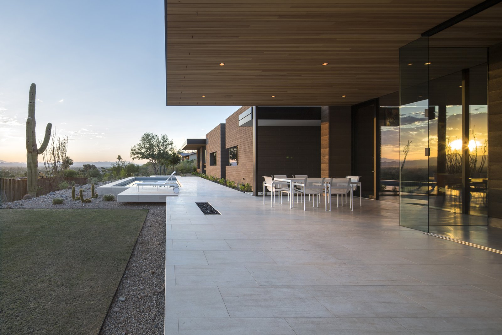 Outdoor, Shrubs, Grass, Back Yard, Trees, Hardscapes, Gardens, Small Pools, Tubs, Shower, Salt Water Pools, Tubs, Shower, Swimming Pools, Tubs, Shower, Large Patio, Porch, Deck, Concrete Pools, Tubs, Shower, Stone Patio, Porch, Deck, Metal Fences, Wall, and Vertical Fences, Wall  Rammed Earth Modern