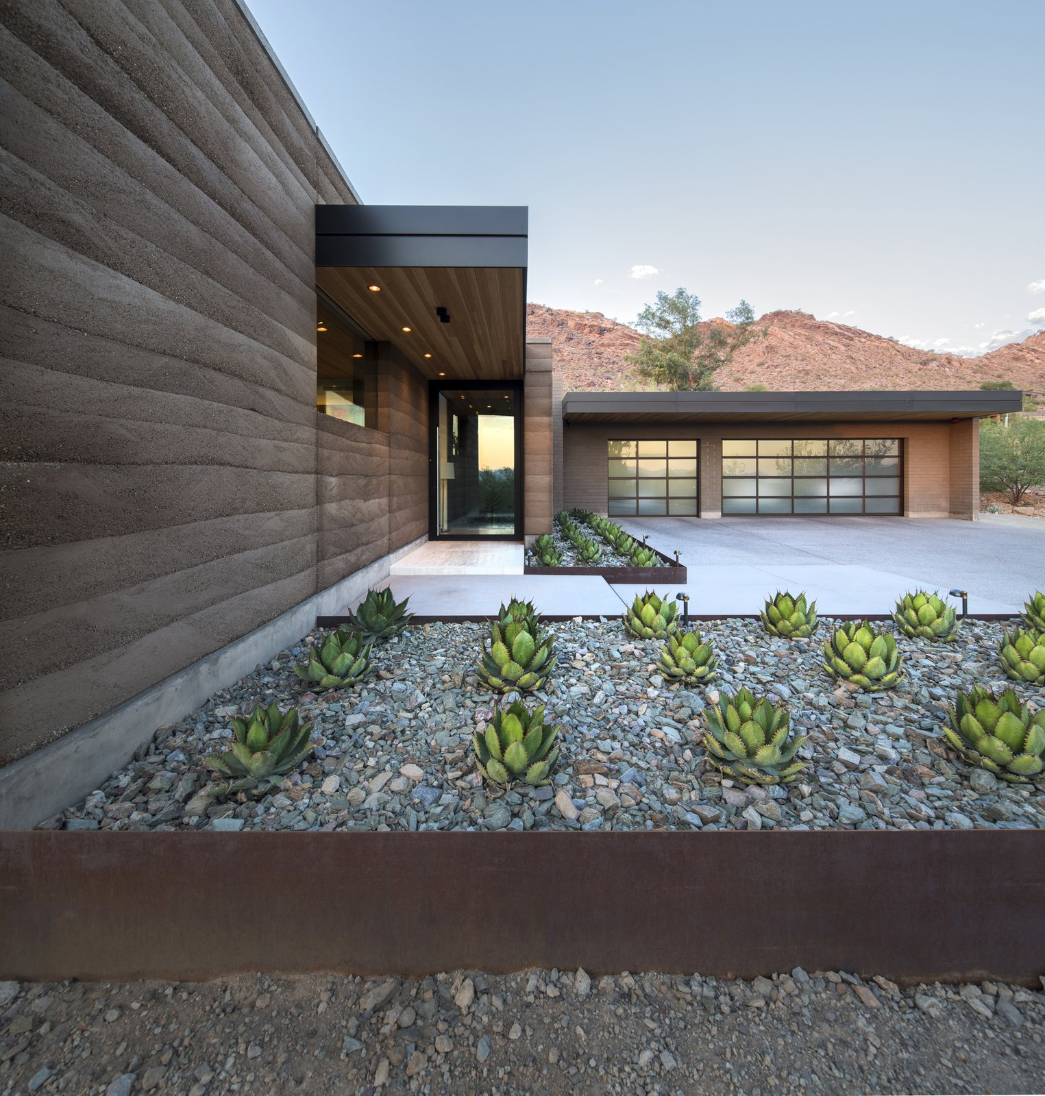 Exterior, House Building Type, Concrete Siding Material, and Metal Roof Material  Rammed Earth Modern