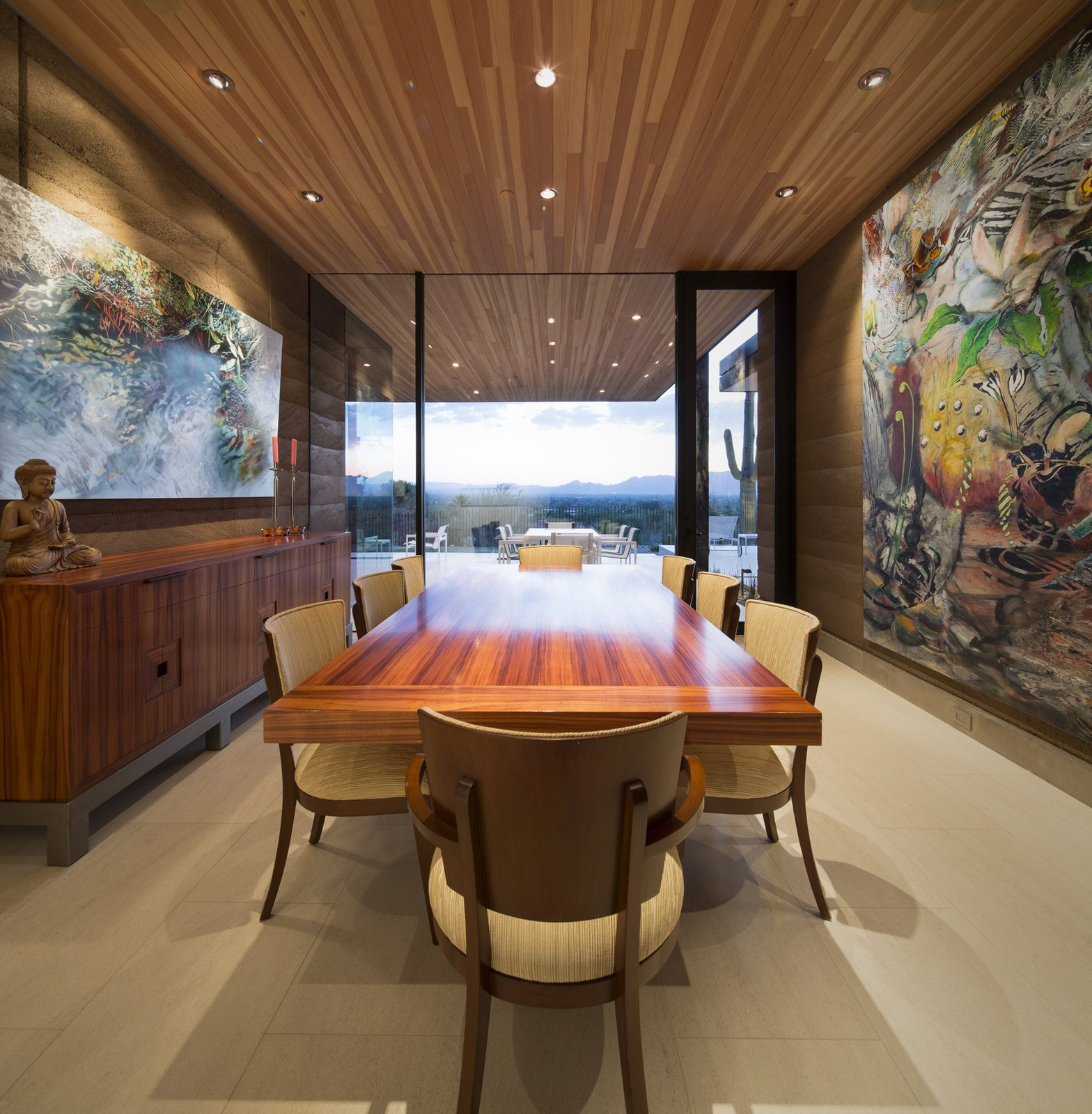 Dining Room, Chair, Limestone Floor, Table, and Recessed Lighting  Rammed Earth Modern
