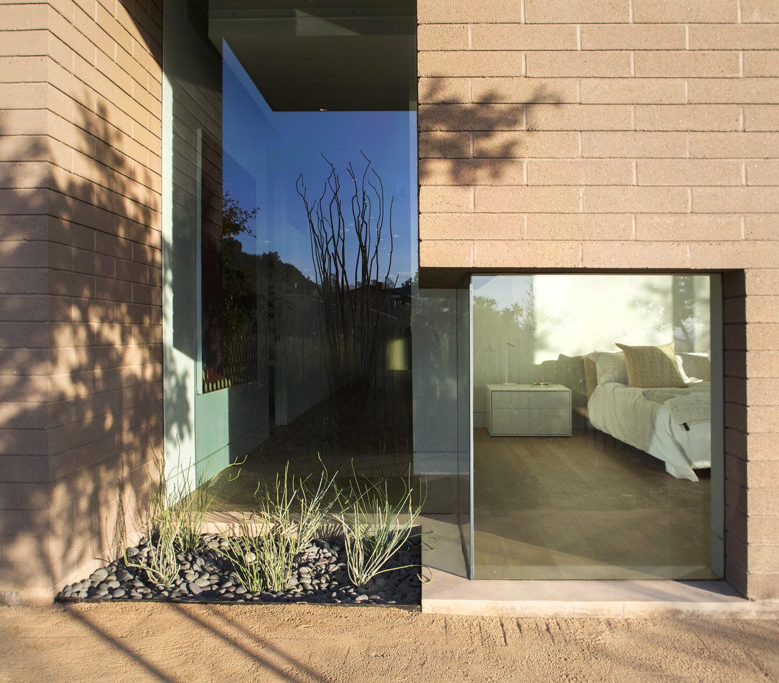 Exterior, House Building Type, Concrete Siding Material, and Brick Siding Material  Rammed Earth Modern