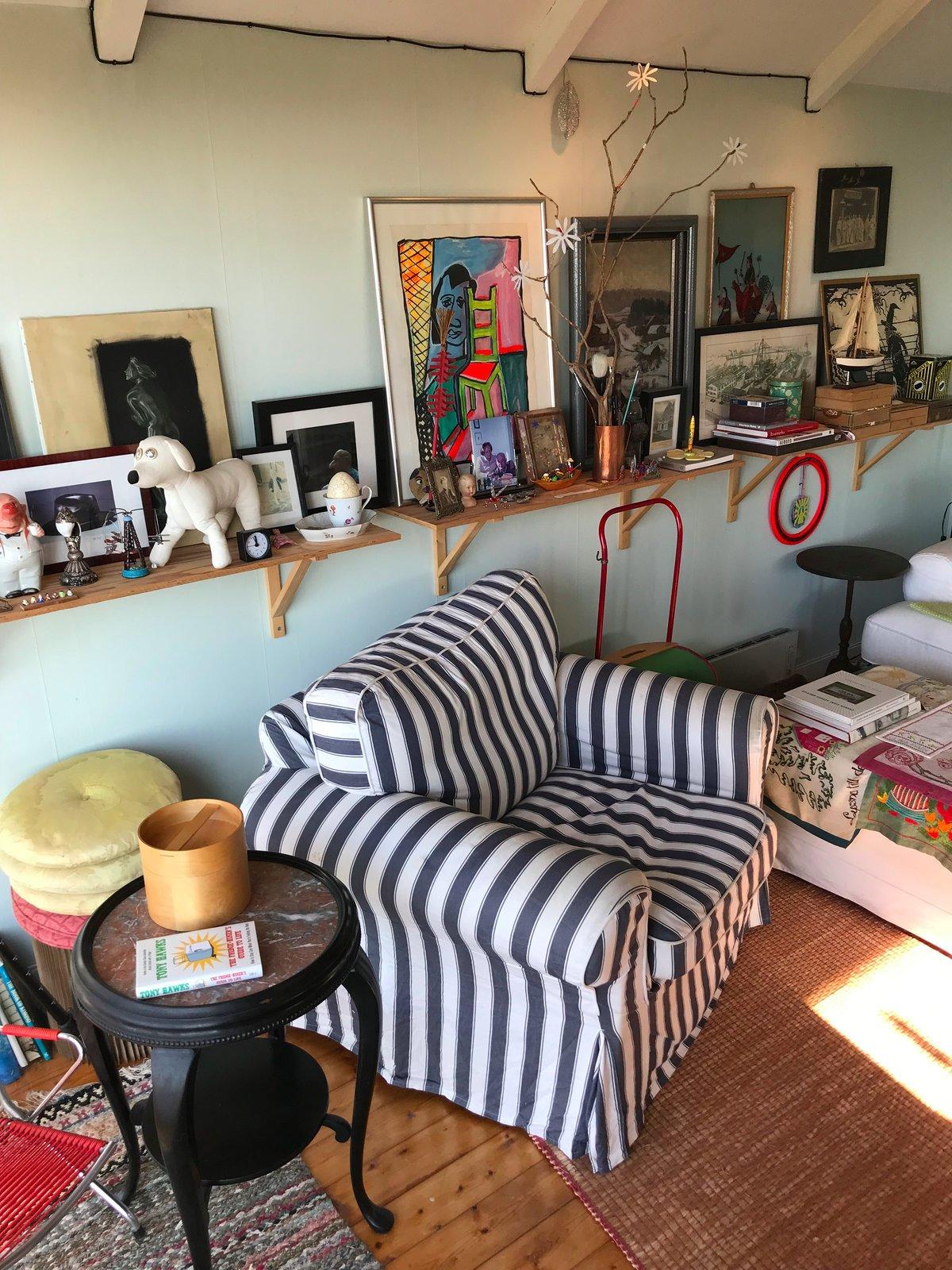 Living Room, Wall Lighting, Sofa, Chair, Ceiling Lighting, Coffee Tables, Floor Lighting, Light Hardwood Floor, Bookcase, Hanging Fireplace, and Wood Burning Fireplace  Paradiso