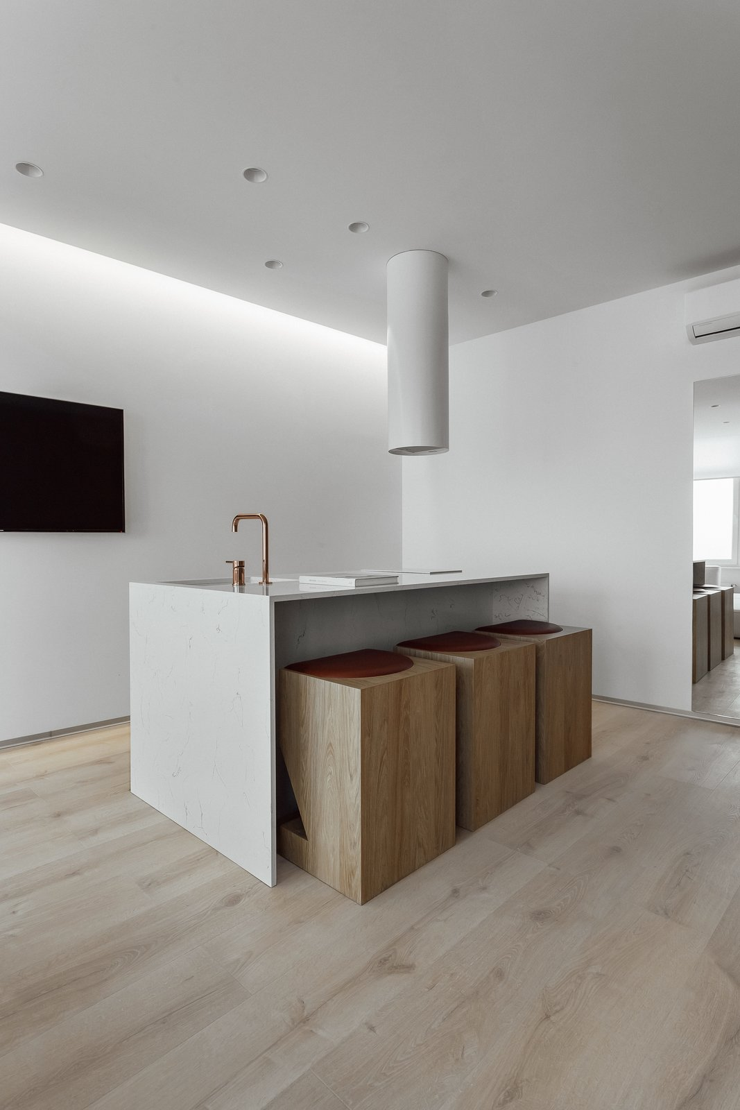Kitchen, Quartzite Counter, Drop In Sink, Ceiling Lighting, White Cabinet, and Light Hardwood Floor  191 Apt.