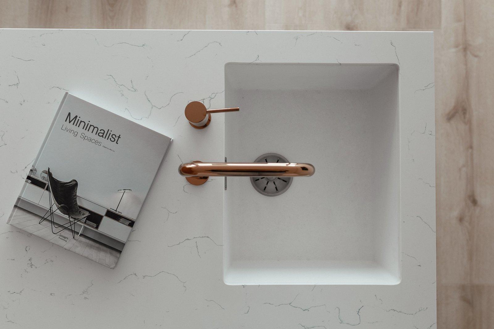 Kitchen, Light Hardwood Floor, White Cabinet, and Quartzite Counter  191 Apt.
