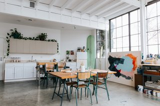 """The dining room table, the flat files bench, and the mobile shelving unit on the second floor were designed by Justin Godar specifically for the space. They all serve multiple purposes, and also marry form with function."""