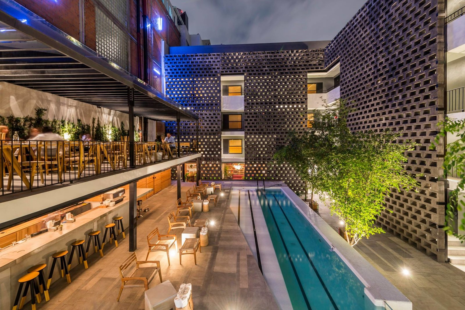 Chic poolside dining at Hotel Carlota.