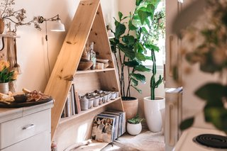Zee and Gong made the triangle shelf for West Coast Craft; afterwards, it made its way Zee's kitchen as a display for books, souvenirs, and her ceramics collection.
