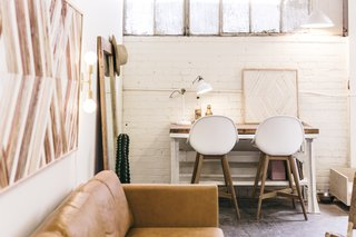 Zee added a desk—a vintage metal piece that she topped with a wood slab—to a dedicated office space.