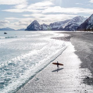 Surfing in Seward, Alaska.