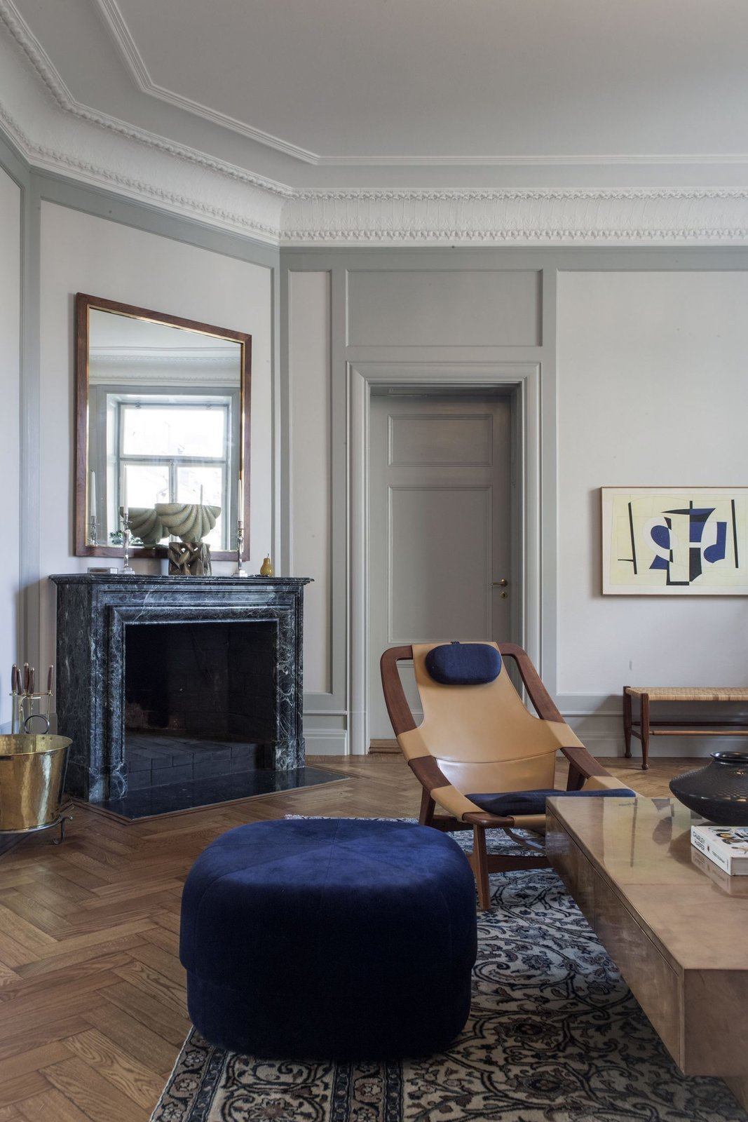 Living Room, Ottomans, Medium Hardwood Floor, Rug Floor, Chair, Standard Layout Fireplace, and Coffee Tables  Photo 3 of 39 in 10 Incredible Interior Designers to Follow on Instagram Right Now