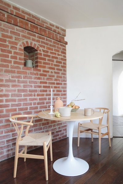 Modern pieces, too, now penetrate the rooms, playing off the curves of the walls and archways. She tries to keep it neutral to complement the existing architecture.