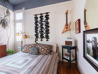 "The guest bedroom oozes retro vibes and features a ""circuit board"" wall hanging by Windy."