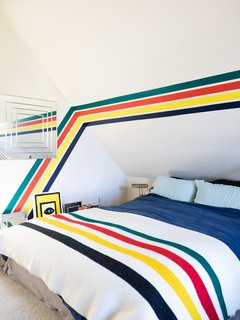 Windy's bedroom is teeming with her favorite Hudson Bay stripes.