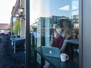 Jenny Xie, executive web editor, works in a phone booth overlooking the terrace.