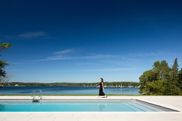 Parallel to the sea, the pool adds to the resort-like ambiance of the home.