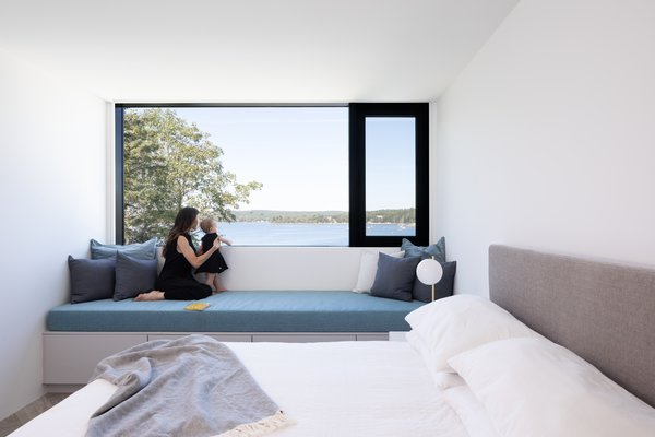 A cozy nook in one of the bedrooms opens up to a coastal breeze.