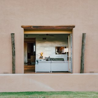 The 5,000-square-foot home has a main house with four bedrooms and three bathrooms, and a one-bed, one-bath casita. It's the epitome of a Santa Fe-style hacienda with a single story, endless loggias, and desert panoramas visible from every room.