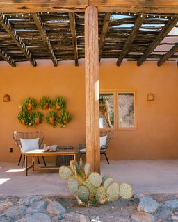 """The [exterior] house color had faded to pink by the time we bought it. We painted it a Sherwin Williams color called Jackson Tan, which melds into the colors of the desert."""