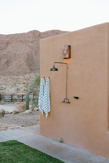 An outdoor shower welcomes Young home after a day out in the dunes.