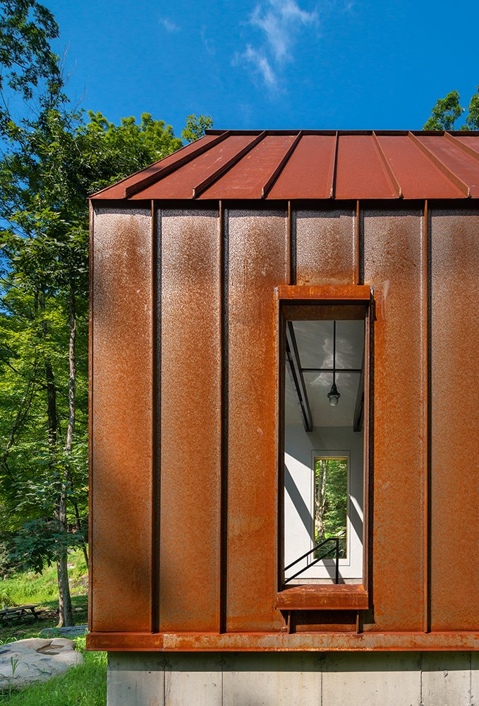 Pond House breezway with Cor-Ten steel exterior