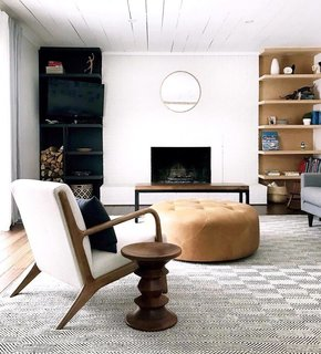 Clare Conklin's living room features subtle earth tones and a mix of wood finishes.