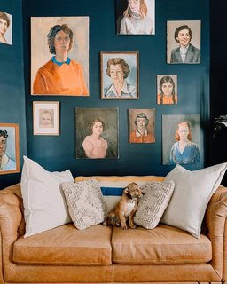 Her pup's favorite spot is the sofa under the art wall, which oozes with strong female energy.