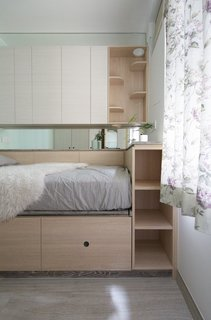 Situated above the bed is a catwalk and cubby with steps.
