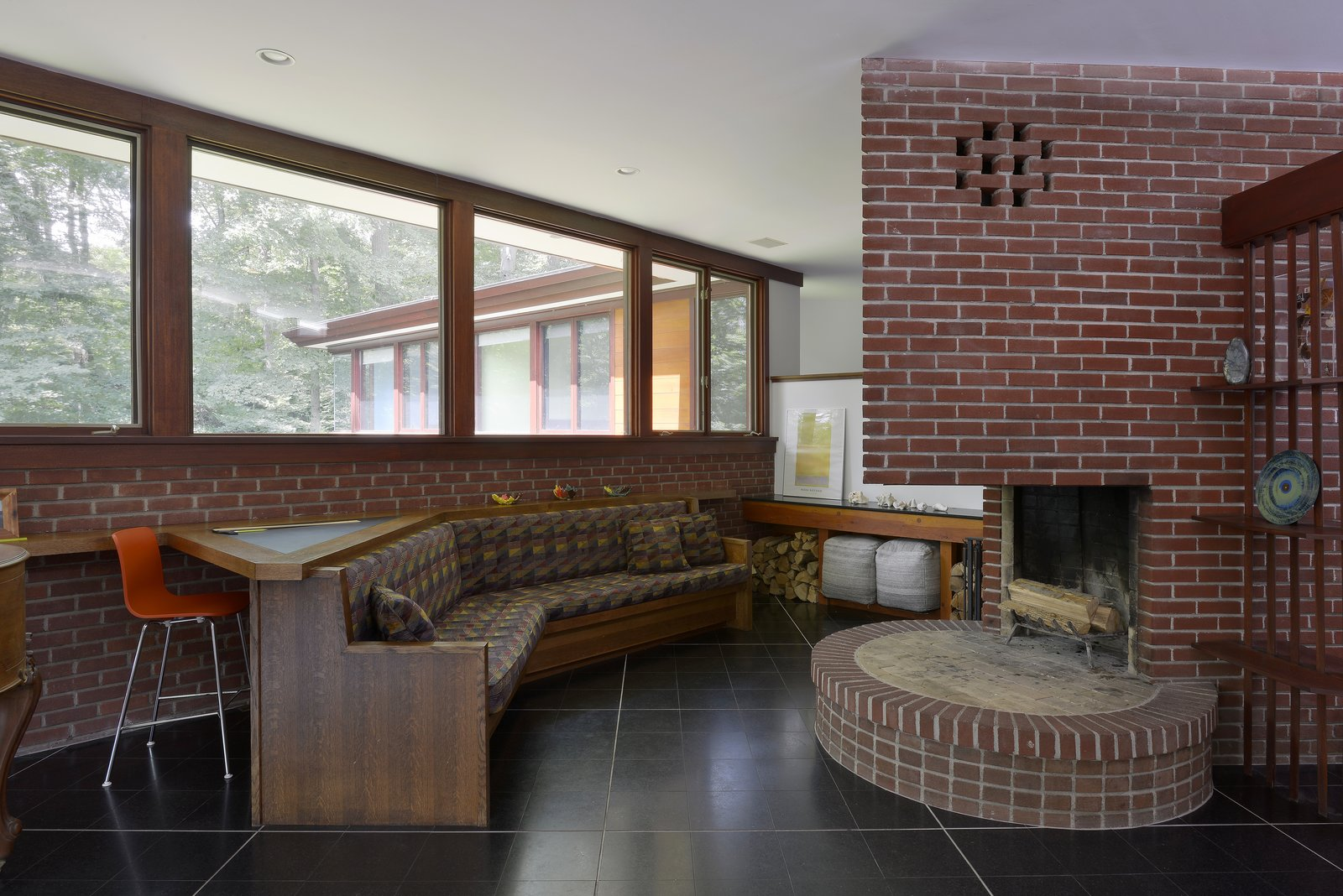 Living, Bench, Standard Layout, Chair, and Desk  Best Living Desk Bench Photos from A Renovated Usonian Gem Shows Off Modern Organic Architecture