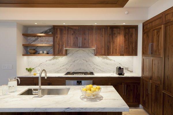 Walnut and book-matched  Calcutta kitchen