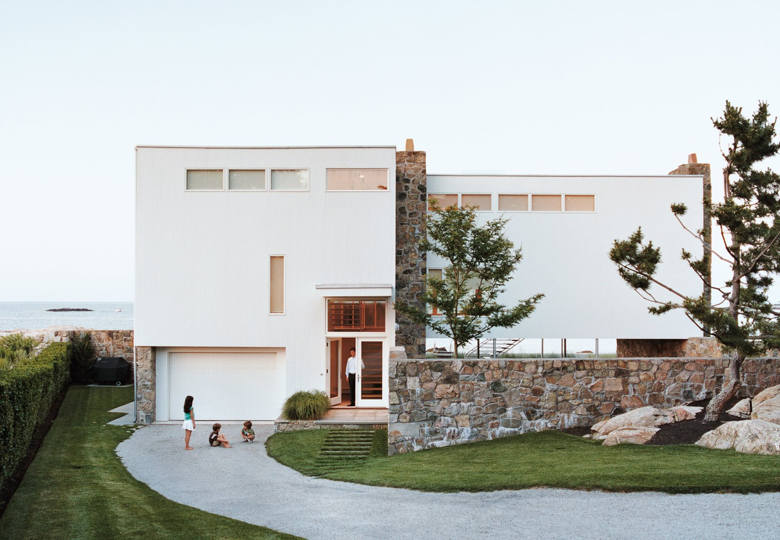 "When this minimalist, L-shaped modern structure was first erected on the Massachusetts coastline, neighbors said it ""looked like the ladies' wing at Alcatraz,"" according to the original resident, John Hagerty. Decades later, guests are still stopping by to explore this inspired Gropius/Breuer collaboration. Exposed pipes and steel staircases provide a streamlined look, while towering glass windows magnify the grandeur of the churning Atlantic Ocean below. Dwell spoke with the current owner, who said the compact-yet-open floor plan results in a ""liberating"" living experience.  Photo 4 of 12 in Design Icon: 10 Buildings by Marcel Breuer"