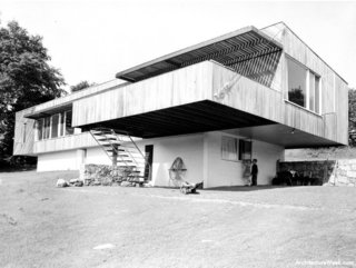 """During the post-war period, the Harvard Five architects turned a Connecticut suburb into a Modernist testing ground, presenting stylish visions of how the era's insatiable construction boom could look. This house was Breuer's first entry into the """"Canaan canon,"""" and it struck quite the chord, literally pushing the boundaries of cantilevered construction. An Architectural Record article from the time gushed that """"the irresistible appeal of the cantilever is here developed to the ultimate degree. What Breuer has done, in effect, is to build a small basement story above ground, and then balance a full-size one-story house nearly atop it."""" A difficult balancing act, to be sure, but the horizontal structure would show Breuer leaning out and pushing the boundaries. He'd later gain notoriety for a second New Canaan house, and a model he built for display in the gardens next to the Museum of Modern Art was one of the institution's most popular and influential architectural displays of the 20th century."""